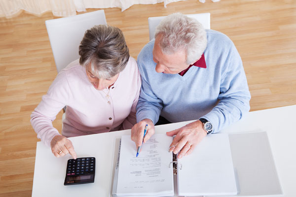 Couple reviewing estate documents created in the Edmonton law offices of Coley Hennessy Cassis with provisions for guardianship, enduring power of attorney and Personal Directive